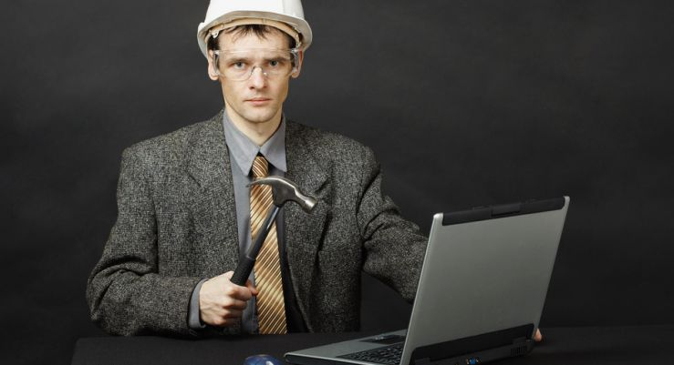 photodune-892179-man-in-helmet-with-hammer-repairs-computer-s-mod.jpg